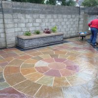 Alpine Garden Services - Sandstone Paving (camel dust) with black limestone boarde